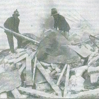 Firemen searching the wreckage of the pub gas explosion