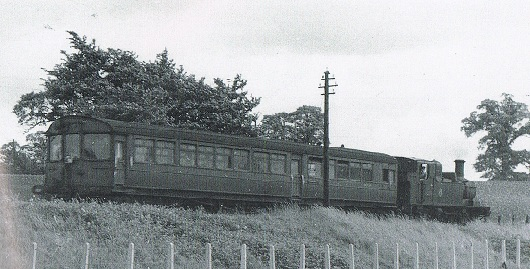Auto trailer leading the engine approaching Calne Junction, Chippenham